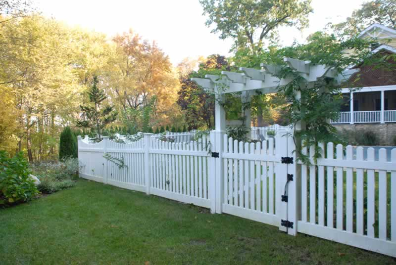 "PVC 3"" Dogear Scalloped Spaced Picket with Matching Gate installed in a Pergola"