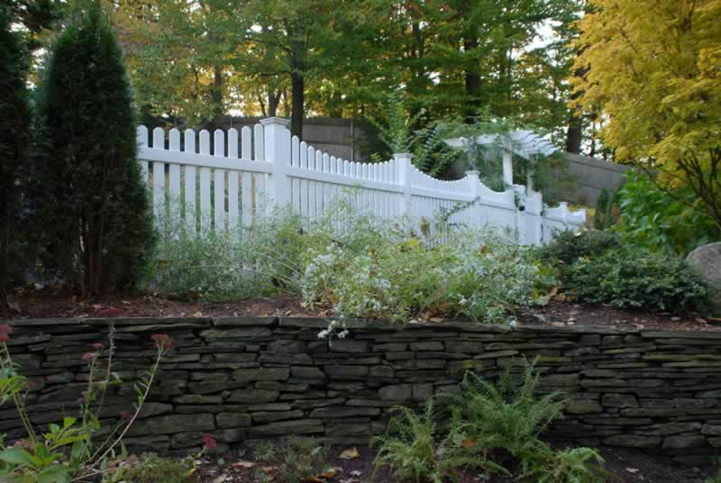 "Classic 3"" Scalloped Picket Fence with Dogear Picket Caps with Gate installed in a Pergola"